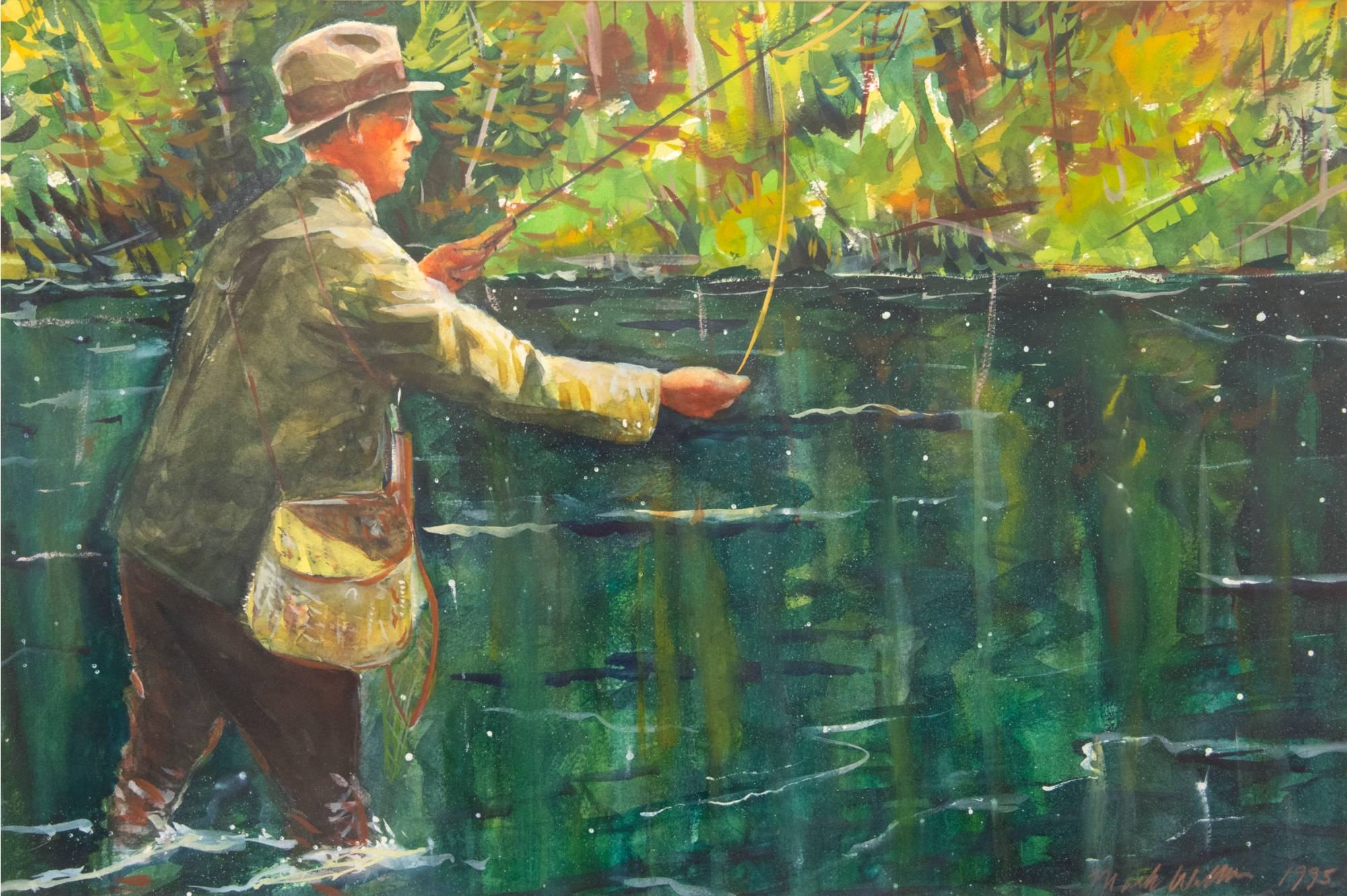 A man standing in the water fly fishing with green foliage in the background.